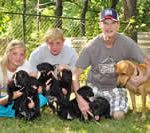 John and family with dogs and puppies